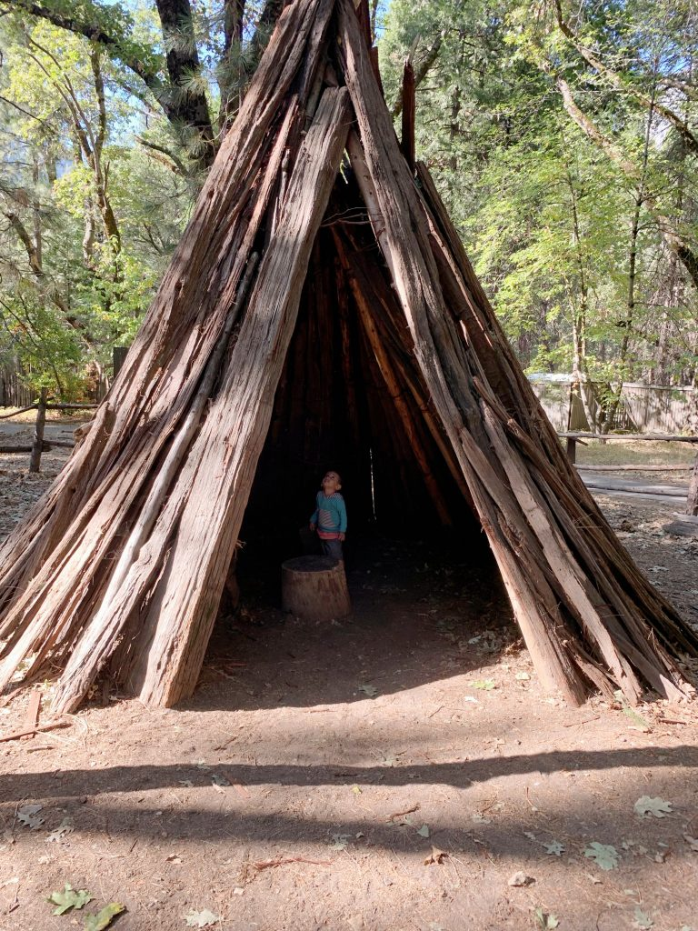 Exploring a teepee at the Indian Village