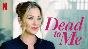 "A blond woman with her hair in a pony tail with hair framing her face.  Text overlay ""Dead to Me"" The Netflix logo is in the top left corner."