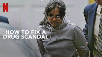 """An Indiana woman in a gray hooded sweatshirt with hands behind back.  A man in a suit is holding her arm and walking beside her.  Text overlay """"How to Fix a Drug Scandel"""" and The Netflix logo is in the top left corner."""
