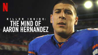 """Aaron Hernandez looking into the camera.  Text overlay """"Killer Inside:  The Mind of Aaron Hernandez"""" The Netflix logo is in the top left corner."""