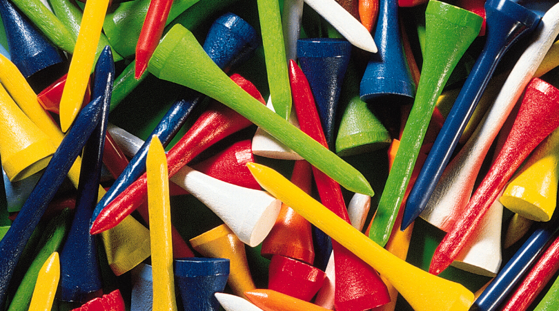 Different colored golf tees in a pile