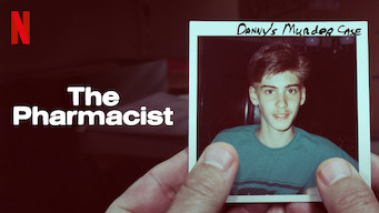 """Two thumbs holding a picture labeled """"Danny's Murder Case"""".  Text overlay of """"The Pharmacist"""" The Netflix logo is in the top left corner."""
