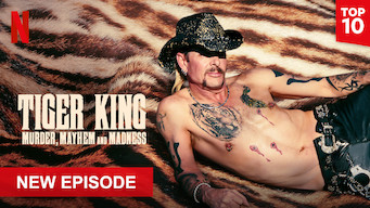 """Joe Exotic lying on a tiger skin rug, shirtless.  Text overlay """"Tiger King: Murder, Mayhem and Madness"""". The Netflix logo is in the top left corner.  Top 10 overlay text in the top right corner.  Text overlay of """"New episode"""" in bottom left corner"""