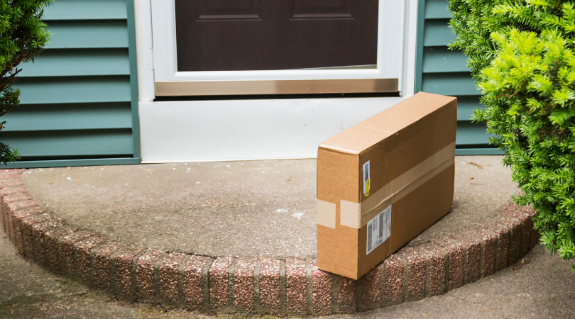A rectangular package on a front doorstep