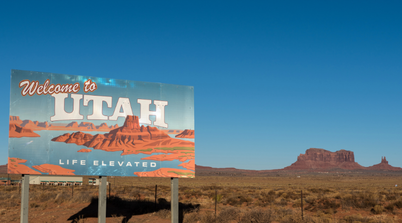 Welcome to Utah sign with a blue sky in the background