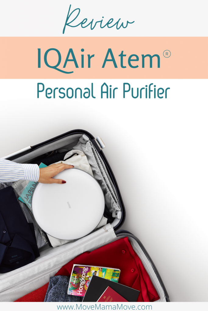 Woman's hand putting IQAir Atem Desk Personal Air Purifier in her suitcase that is packed