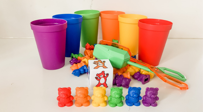 Counting bears set, including 6 colored cups, tongs, dice, and colored bears