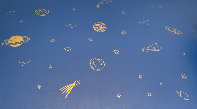 Blue wall with gold space decals