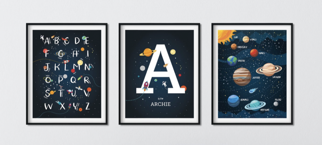 """three framed pieces of space-themed art in a horizontal row.  The first framed art is the alphabet with planets, starts, and other space elements decorating the page.  The second frame is the letter A with space decor.  The bottom of the artwork says """"Archie"""".  The third frame is the planets and the sun, in order with orbits."""
